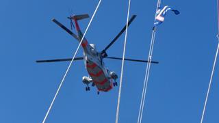 De heli boven de boot